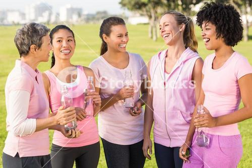 Women wearing pink for breast cancer and talking