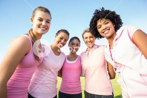 Smiling women wearing pink for breast cancer