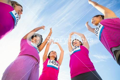 Five cheering runners supporting breast cancer marathon