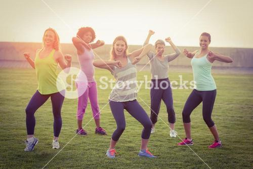 Happy sporty women dancing during fitness class