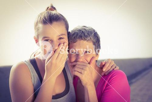 Sporty mother and daughter laughing