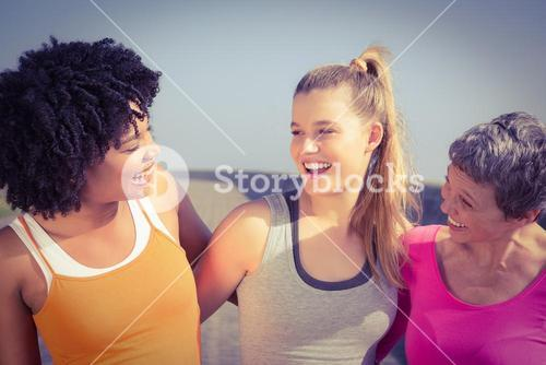 Sporty women smiling at each other