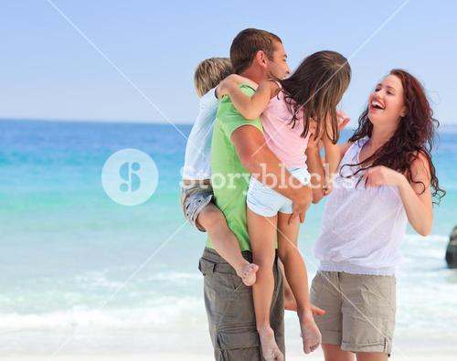 Happy children playing with their parents