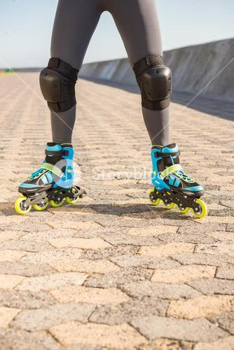 Close up view of woman wearing inline skates