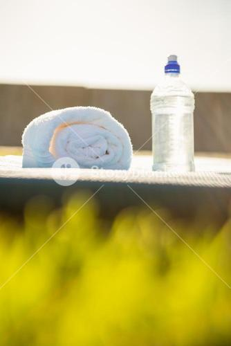 Water bottle and towel on exercise mat