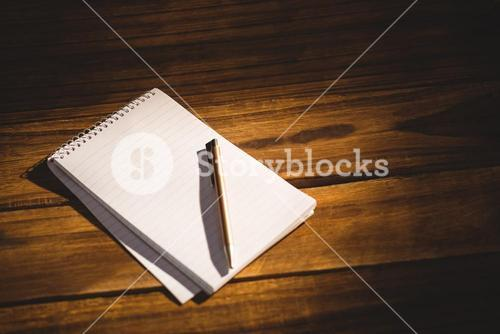 View of a notepad with pen