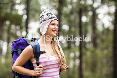 Young happy hiker looking in the distance