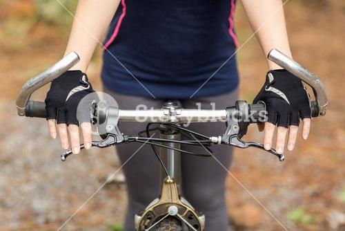 Close up view of hands on handlebar