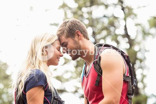Happy young couple touching foreheads