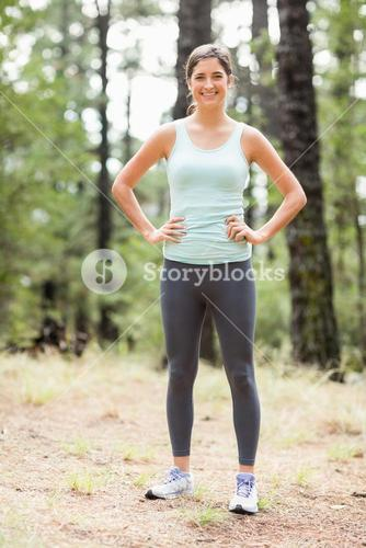 Young happy jogger standing