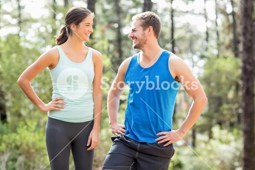 Happy joggers looking at each other