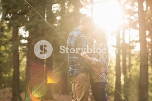 Happy couple embracing at sunset