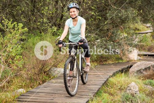 Smiling fit woman cycling her bike