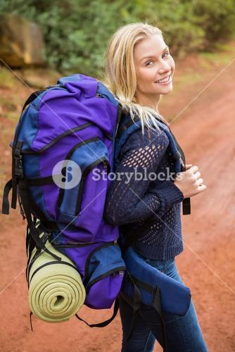 Smiling female hiker looking at the camera