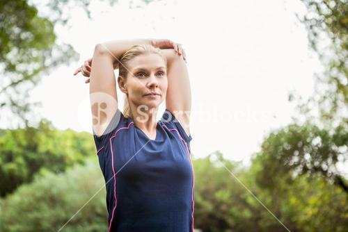 Athletic woman doing arms stretching