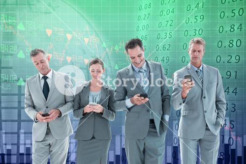 Composite image of employees using their mobile phone