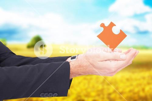Composite image of businessman with arms out presenting something