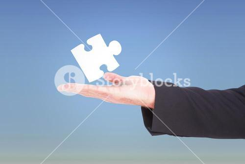 Composite image of businessman holding hand out in presentation