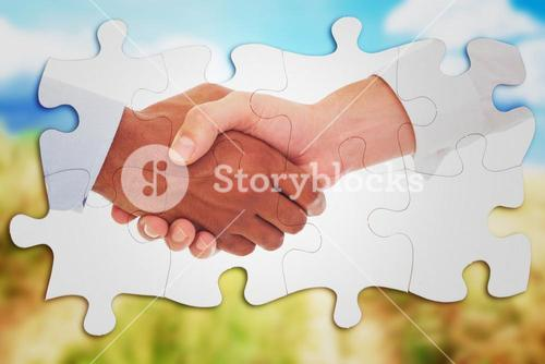 Composite image of close-up shot of a handshake in office