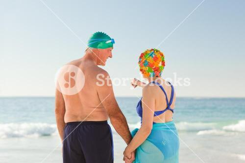 Enamored elderly couple at the beach