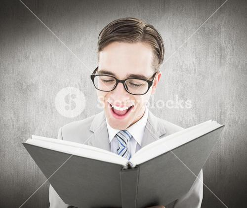 Composite image of geeky preacher reading from black bible