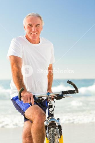 Senior man with his bike