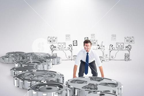 Composite image of businessman bending and lifting