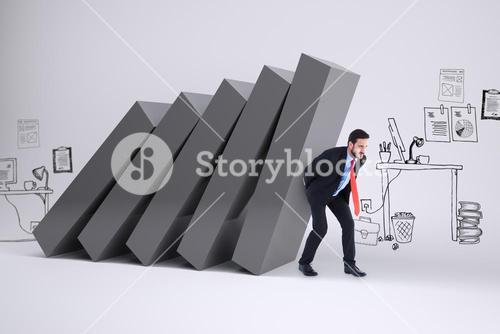Composite image of businessman in suit carrying something heavy