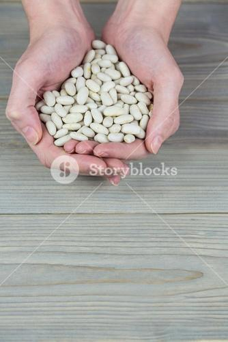Woman showing handful of lima beans