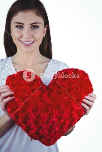 Woman holding heart shape cushion