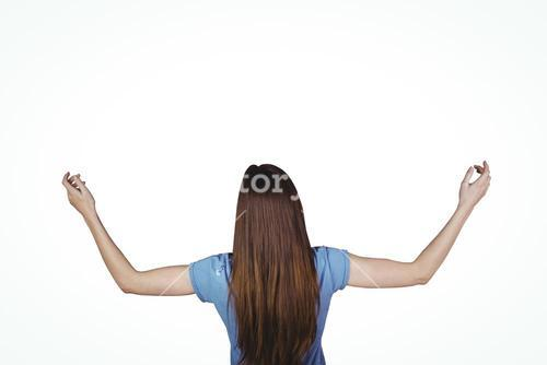 Pretty brunette with arms raised