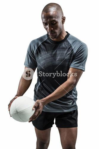 Athlete looking at rugby ball