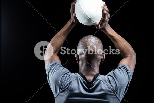 Sportsman throwing rugby ball