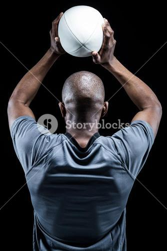 Athlete throwing rugby ball