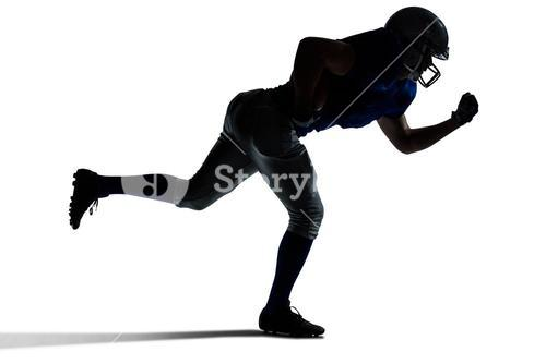 Silhouette American football player running