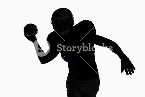 Silhouette sportsman throwing football