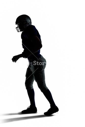 Silhouette American football player walking