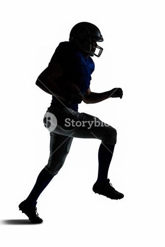 Silhouette American football player runing
