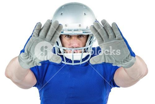 Portrait American football player defending