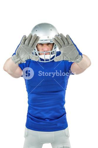 Confident American football player defending
