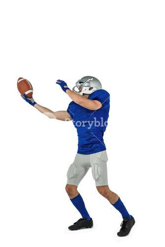 American football player catching ball