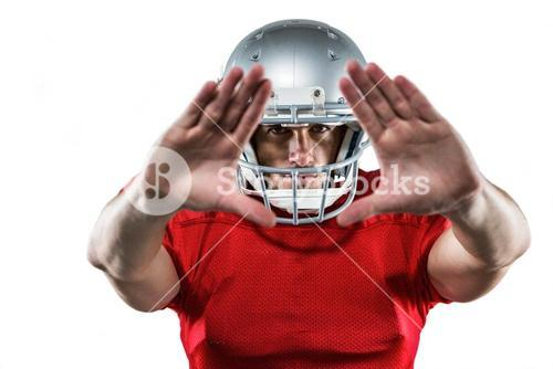 American football player in red jersey defending
