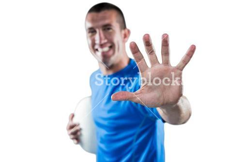 Portrait of happy rugby player defending