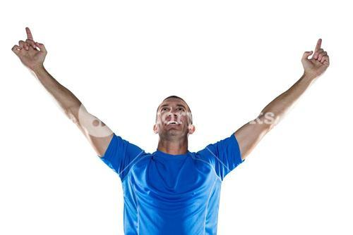 Happy rugby player with arms raised