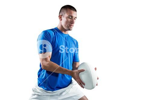 Rugby player in blue jersey holding ball