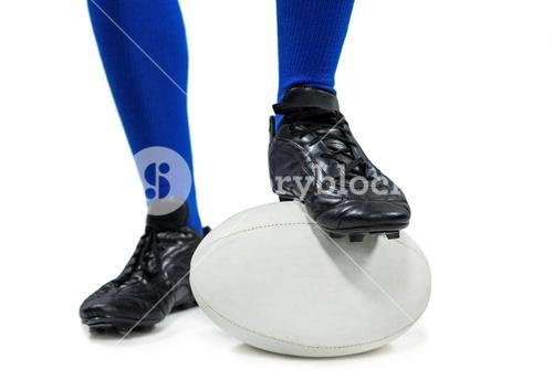 Low section of of rugby player on ball