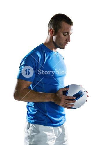 Thoughtful sports player holding ball