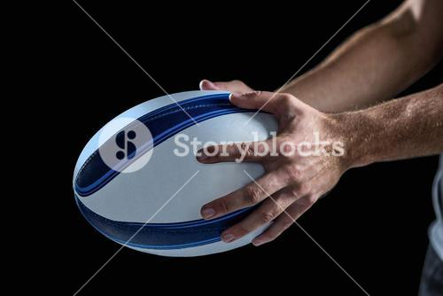 Cropped image of sports player holding ball