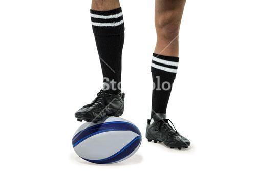 Rugby player in black socks on ball