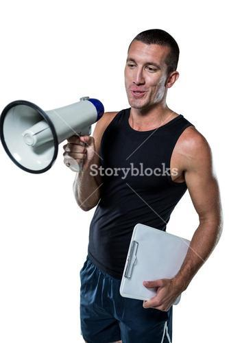 Trainer using megaphone while holding clipboard